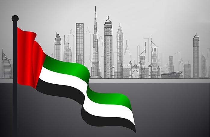 UAEの国旗と都市のシルエット